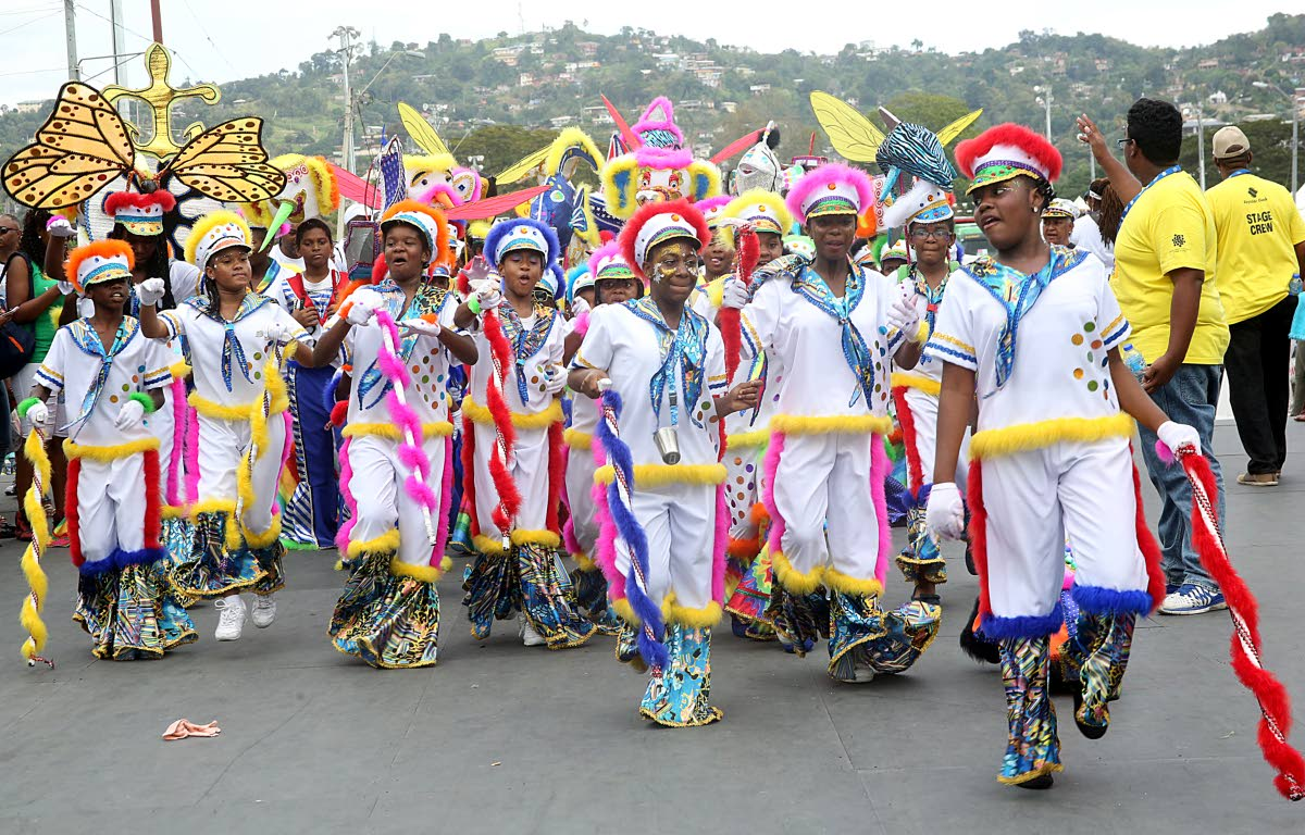 Masqueraders from the band Fancy Sailors Thru the Years cross Queen's Park Savannah at the 2017 Junior Parade of the Bands.