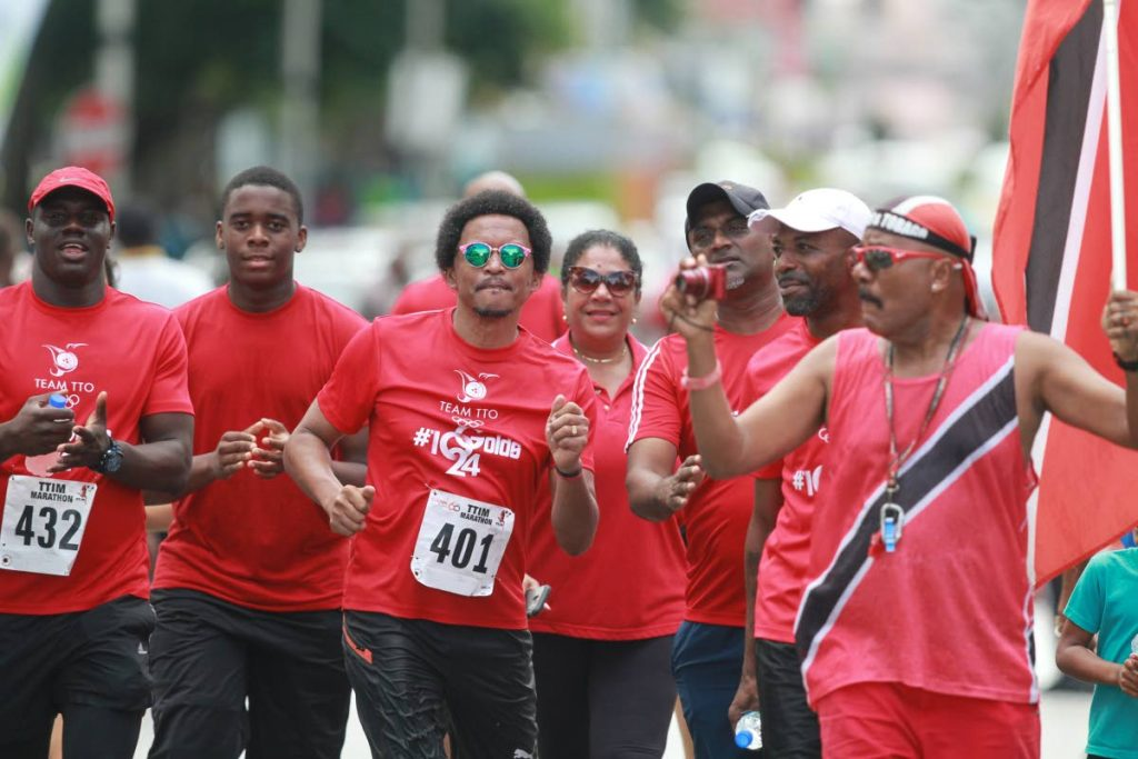 TTOC president Brian Lewis (centre) is urged on by is supporters as he approaches the finish line at the 2018 TT international marathon in Port of Spain. PHOTO BY NICHOLAS BHAJAN/CA-IMAGES
