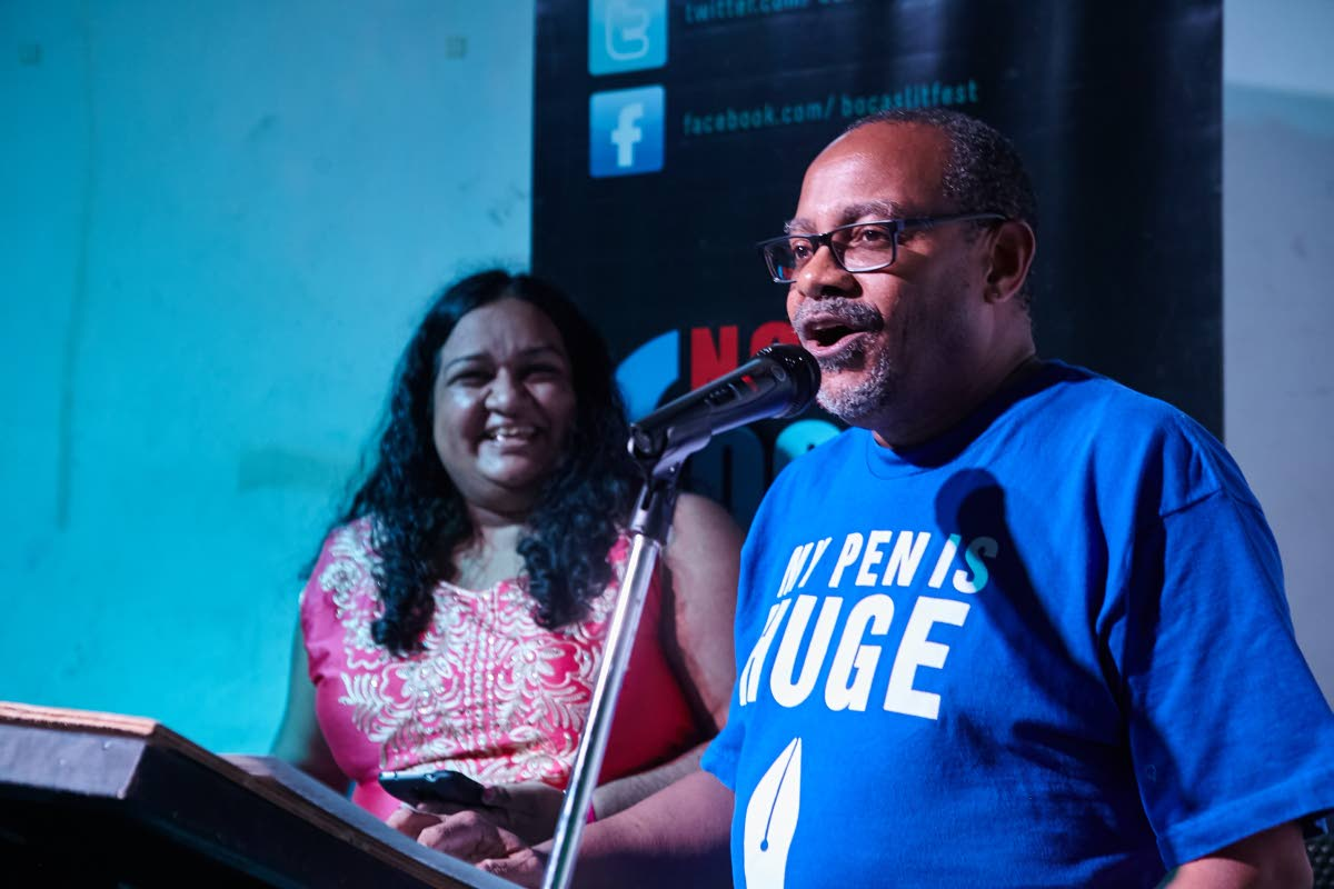 Poet Shivanee Ramlochan laughs as author Colin Robinson address the audience at Backchat: Port of Spain at the  Euphoria Lounge. PHOTO COURTESY BOCAS LIT FEST