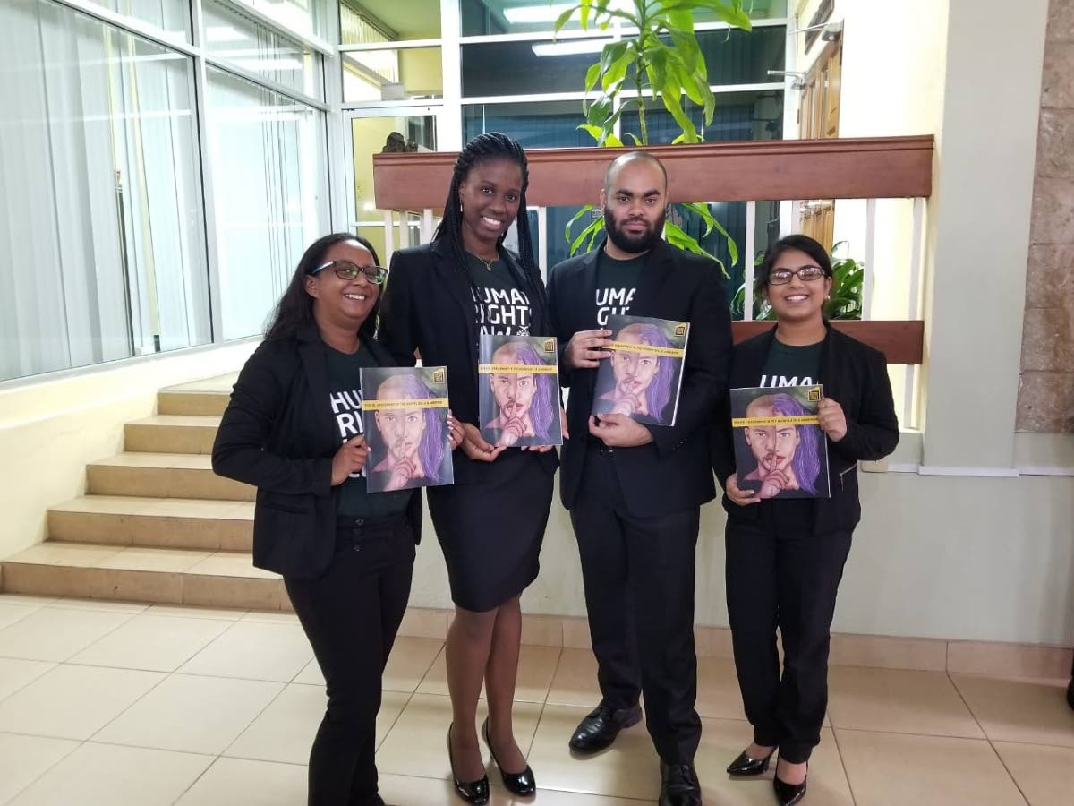 Hugh Wooding Law School year-two students  Sara  Martinez, left, Rachel Weekes, Ansar  Mohammed and Casiana Sankar pose with their  Sexual Harassment  Workbook.