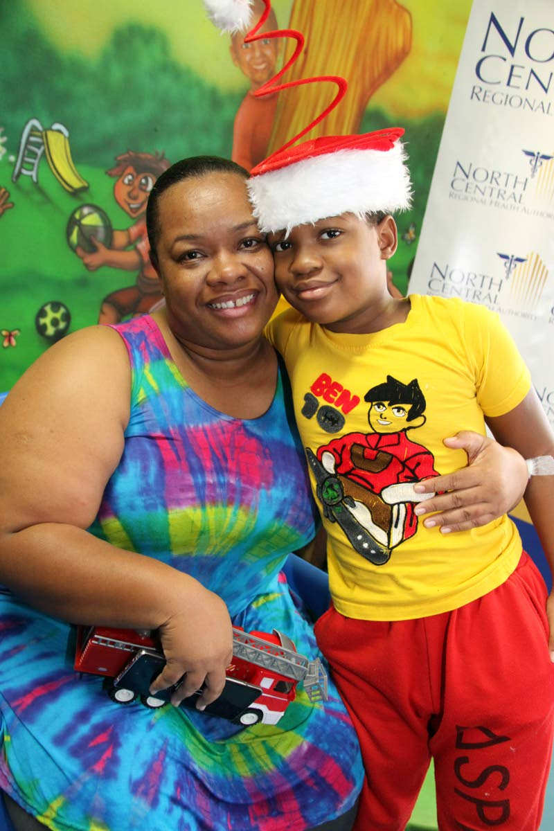 Keanu Alleyne, 10, hugs his mother  Laurel David at Wendy Fitzwilliam Paediatric Hospital, Eric Williams Medical Sciences, Complex Mt Hope on Boxing Day. Shortly before Christmas Keanu was diagonsed with Type 1 diabetes. Doctors advised with medication, a healthy diet and regular exercise Keanu would live a healthy life. PHOTO SUREASH CHOLAI