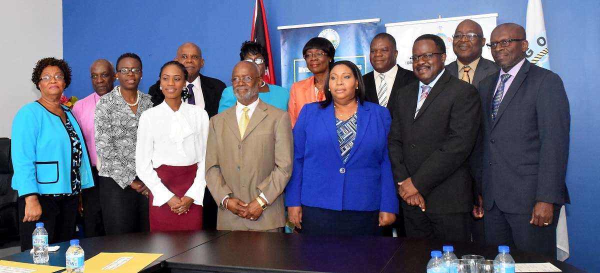 Members of the Board of the Tobago Regional Health Authority pose for a photo with Chief Secretary Kelvin Charles, second from right, back row, and Health Secretary Dr Agatha Carrington, fourth from right, back row, at a retreat at the Division of Health in July last year. At left is Ashworth Learmont is then Chief Executive Officer who resigned in August following his June appointment, and Ingrid Melville, Chairman, second from left.