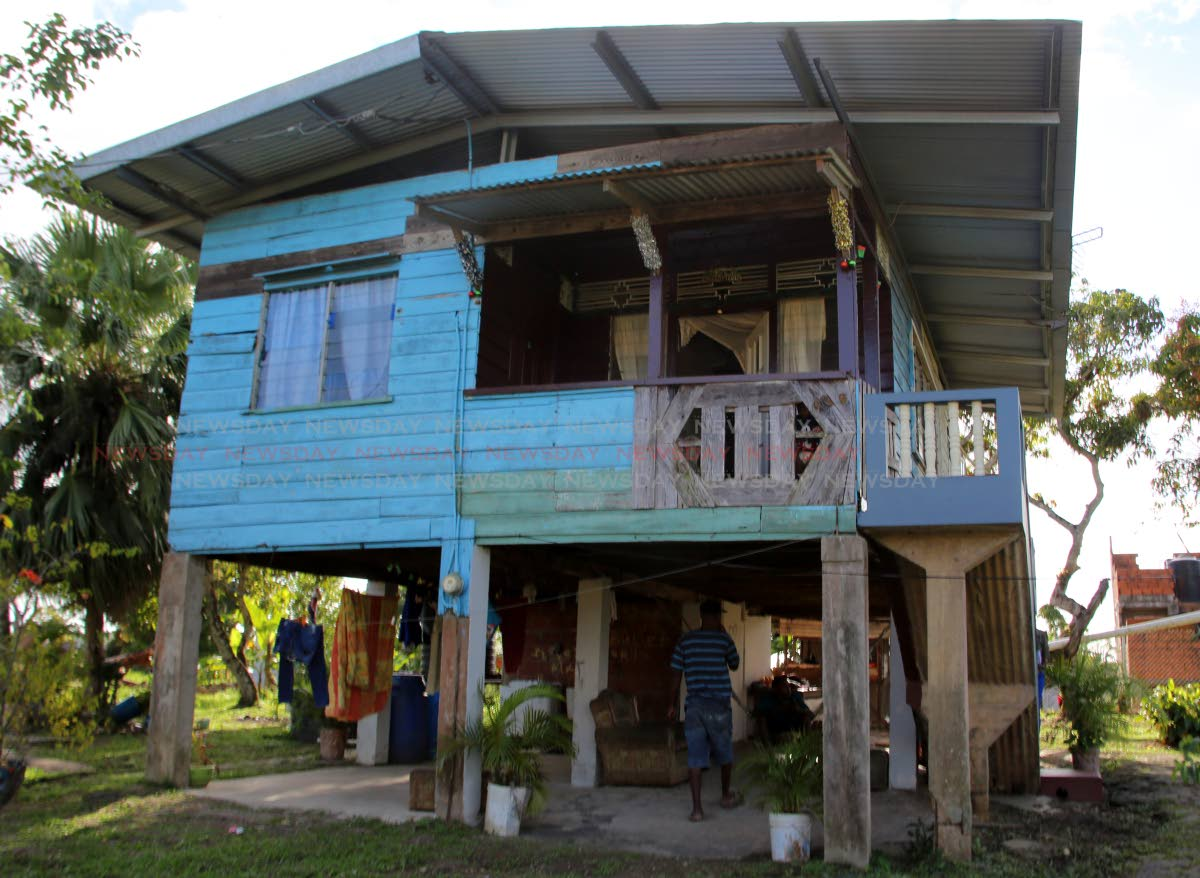 FALL FROM PORCH: The humble home of two-month-old Revolino John-Williams in Point Fortin. Last Sunday, baby Revolino's mother Shada tripped while she was holding him and the baby fell from the porch, landing seven feet below to the ground. Photo by Vashti Singh
