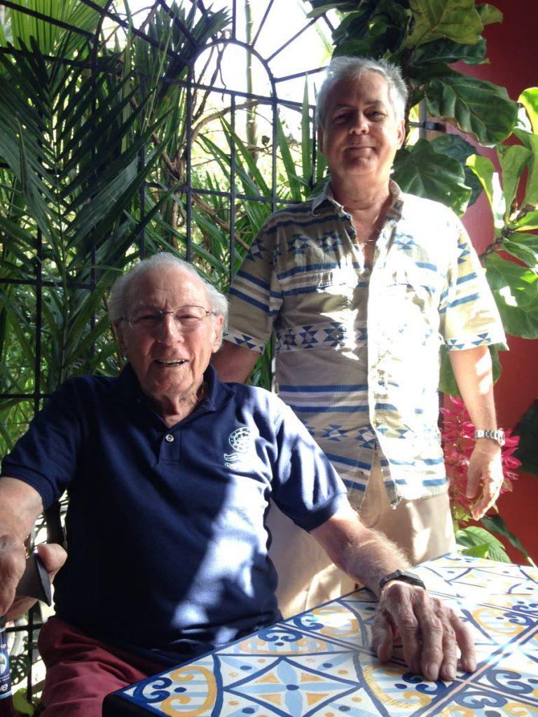 German-born Peter Laband, seated, with Dr Stuart Millar at Millar's home, Maraval, on December 27, 2018. Laband and Millar's late father Ian were classmates at QRC when Laband lived in Trinidad as a WWII refugee.