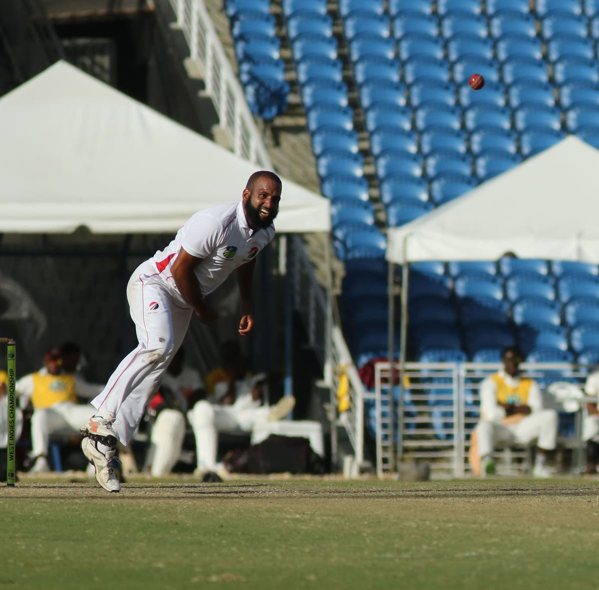 Red Force spinner Yannic Cariah sends down a delivery against the Leewards at the Brian Lara Academy, Tarouba, yesterday.