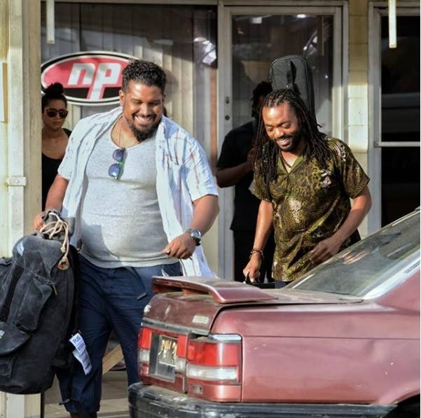 MONK AND HIS BUD: Soca star Machel Montano (left) and late actor Chris Smith in a scene from the 2016 film Bazodee.