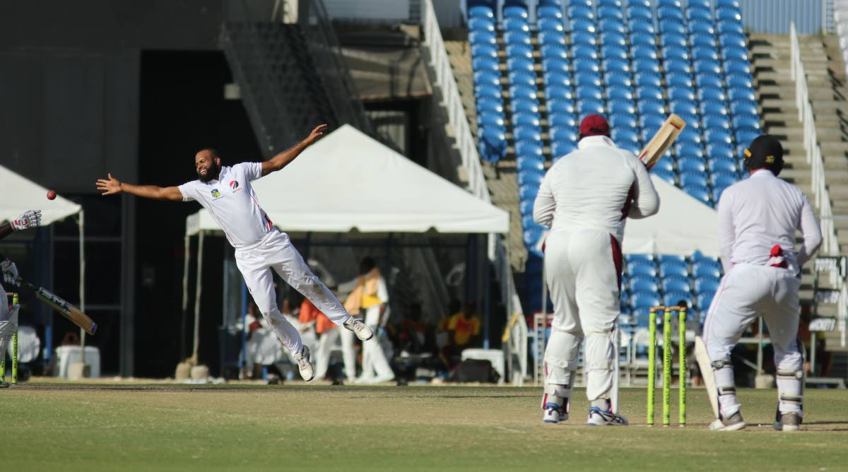 Leewards Islands batsman Rahkeem Cornwall plays a shot down the ground past Red Force spinner Yannic Cariah on day three of their four-day match at the Brian Lara Academy, Tarouba, Sunday. Photo by Vashti Singh