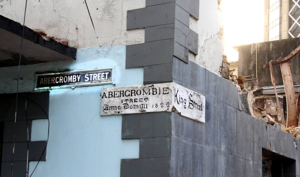 Conservationists hope this stone sign set into the walls of the Ansa McAl building in Port of Spain, which is being demolished, can be preserved because of its historical value to the nation. Photo by Sureash Cholai