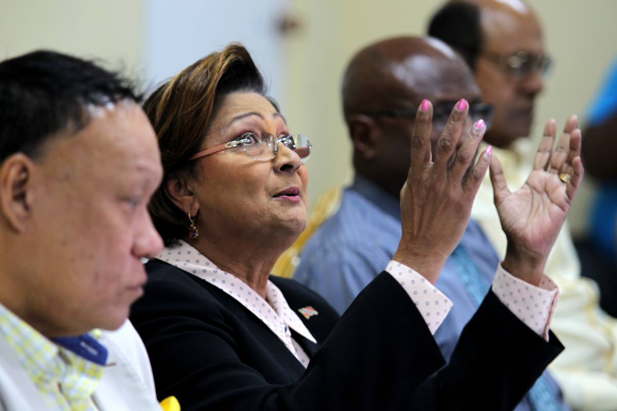 PAGE 3 MAIN PHOTO  PUT A HAND: Opposition Leader Kamla Persad-Bissessar gestures during a press conference yesterday. PHOTO BY LINCOLN HOLDER