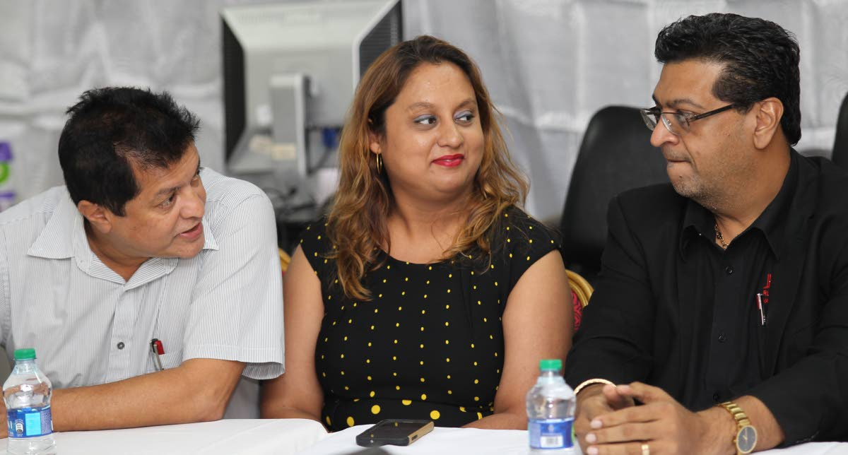 Opposition MPs Dr Lackram Bodoe, Ramona Ramdial and Rushton Paray at a press conference in Couva last year. Bodoe yesterday advised pregnant women to get the H1N1 vaccine. FILE PHOTO