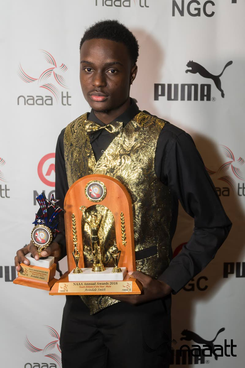 Youth Athlete of the Year Avindale Smith has his hands full at the NAAA awards ceremony on Saturday.