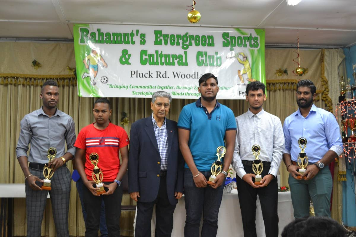 Chairman of The Rahamut Group of Companies Azard Rahaman, third from left, with some of the Evergreen Sports Club's top performers (from left) Travis Blyden, Kerion Rampersad, Mark Bisnath (representing Alvin Ramlogan), Lorenzo Loubon and Christian Sookhansingh at their awards ceremony recently.