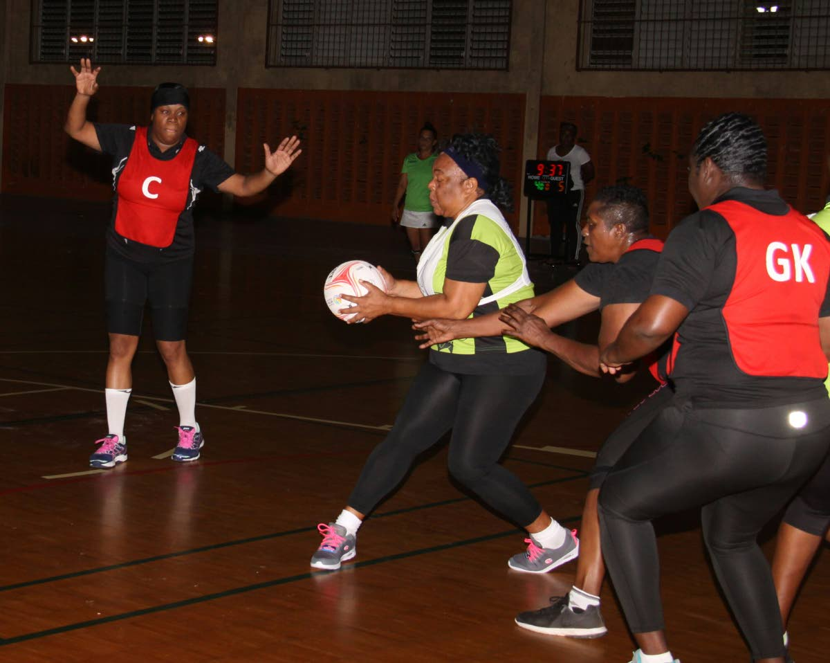 A TSTT player looks to make a pass against Police in a Courts All Sectors Netball League Retro Division match at the Eastern Regional Indoor Sports Arena, Tacarigua, Monday. PHOTO BY ANGELO MARCELLE