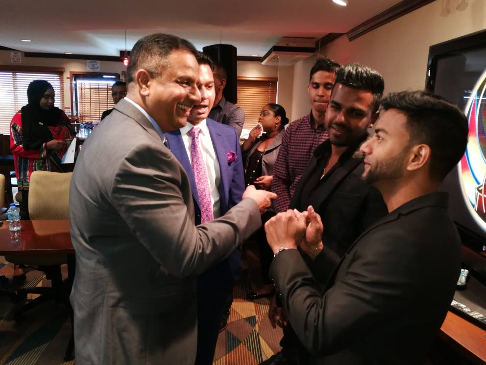 """Southex CEO George Singh, left, shares a joke with Rajkavir Singh, Southex director and defending Chutney Soca Monarchs Nishard """"Nishard M"""" Mayrhoo and Neval Chatelal at the NLCB Corporate Box, Queen's Park Oval, Woodbrook. PHOTO BY JOAN RAMPERSAD"""