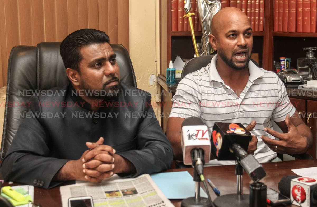 Attorney Gerald Ramdeen, left, looks on as former Red Force assistant coach Imran Jan defends himself against accusations that he colluded with the TT Cricket Board president while as a director with the Sport Company.  The press conference was held yesterday at the Law Chambers of Gerald Ramdeen, Woodbrook. PHOTO BY JEFF MAYERS