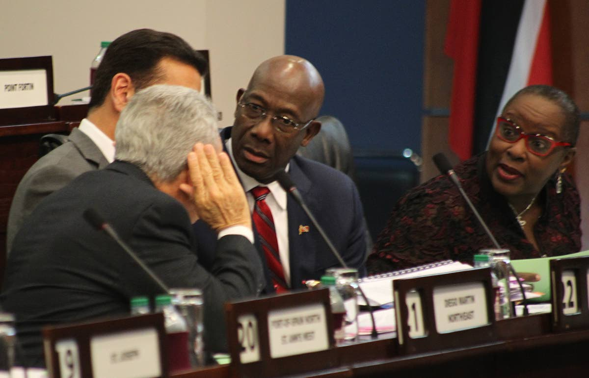 Prime Minister Dr Keith Rowley and Chief Whip and Minister of Planning and Development Camille Robinson-Regis focus their attention towards Finance Minister Colm Imbert alongside Attorney General Faris Al-Rawi at yesterday's sitting of the Lower House of Parliament in Port of Spain. PHOTO BY ROGER JACOB.