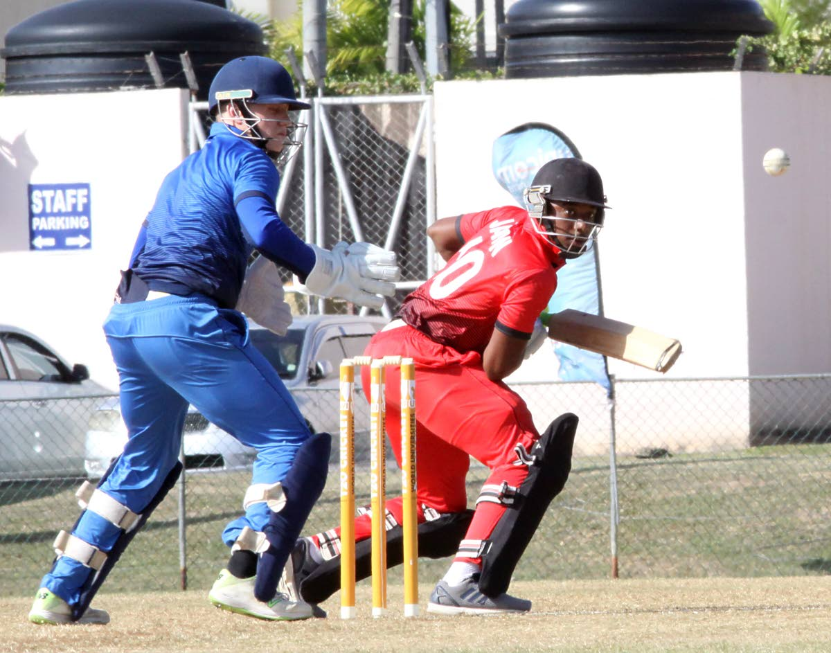 TSATT batsman Jabari Mills guides a delivery past Oxford Marylebone Cricket Club University wicketkeeper Matthew Taylor yesterday in a World Universities T20 match at the Sir Frank Worrell Ground, St Augustine. PHOTO BY ANGELO MARCELLE