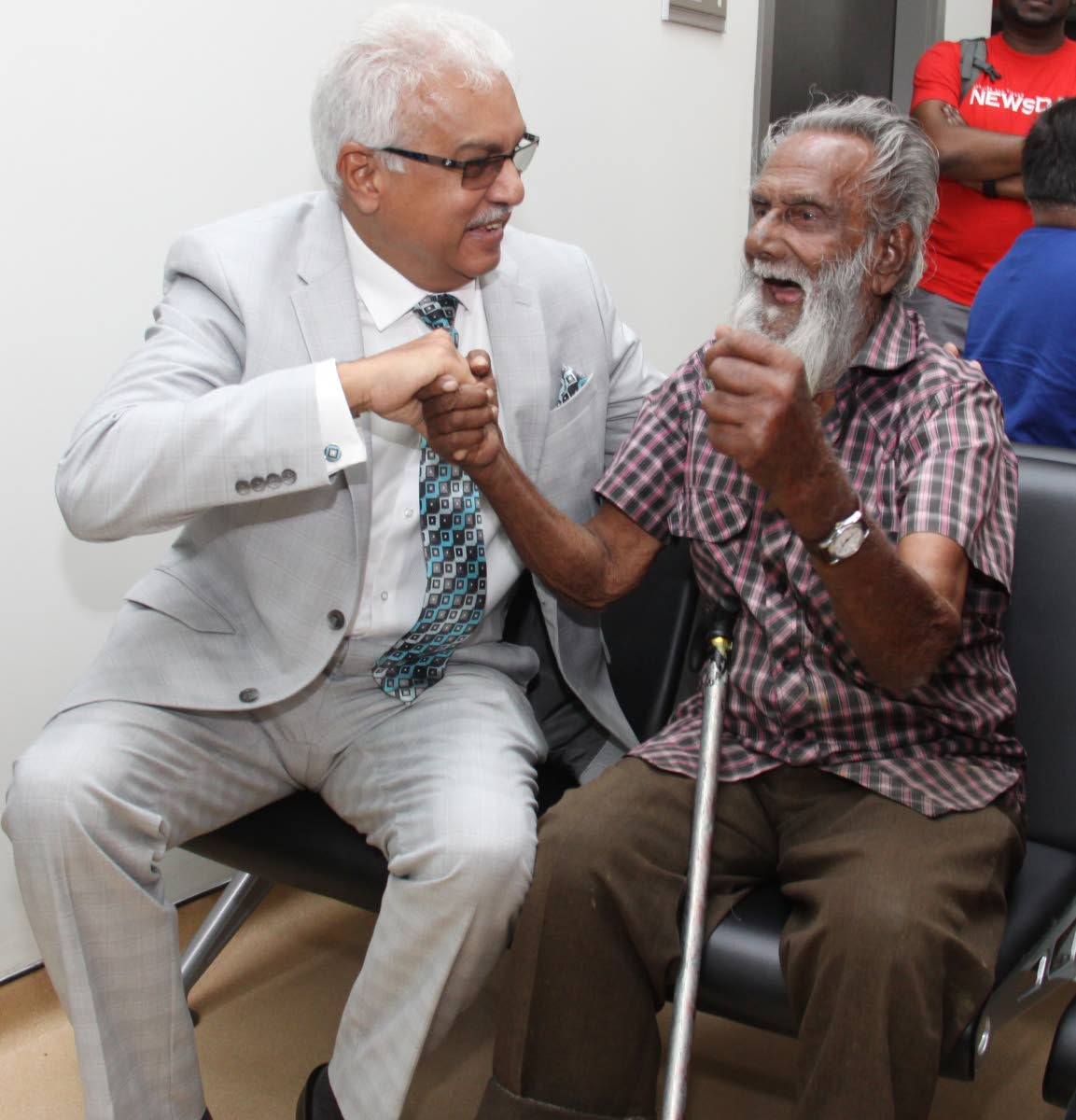 Hafic Ali, 92, tests his strength against Health Minister Terrence Deyalsingh at the opening of the Sangre Grande Enhanced Health Centre, Sangre Grande yesterday.