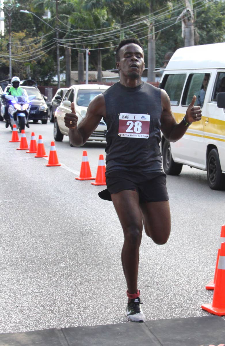 Cy Sarjeant crosses the finish line yesterday to win the TTUTA Teacher's one-lap event, at the Queen's Park Savannah, Port of Spain.  Phot: Angello Marcelle