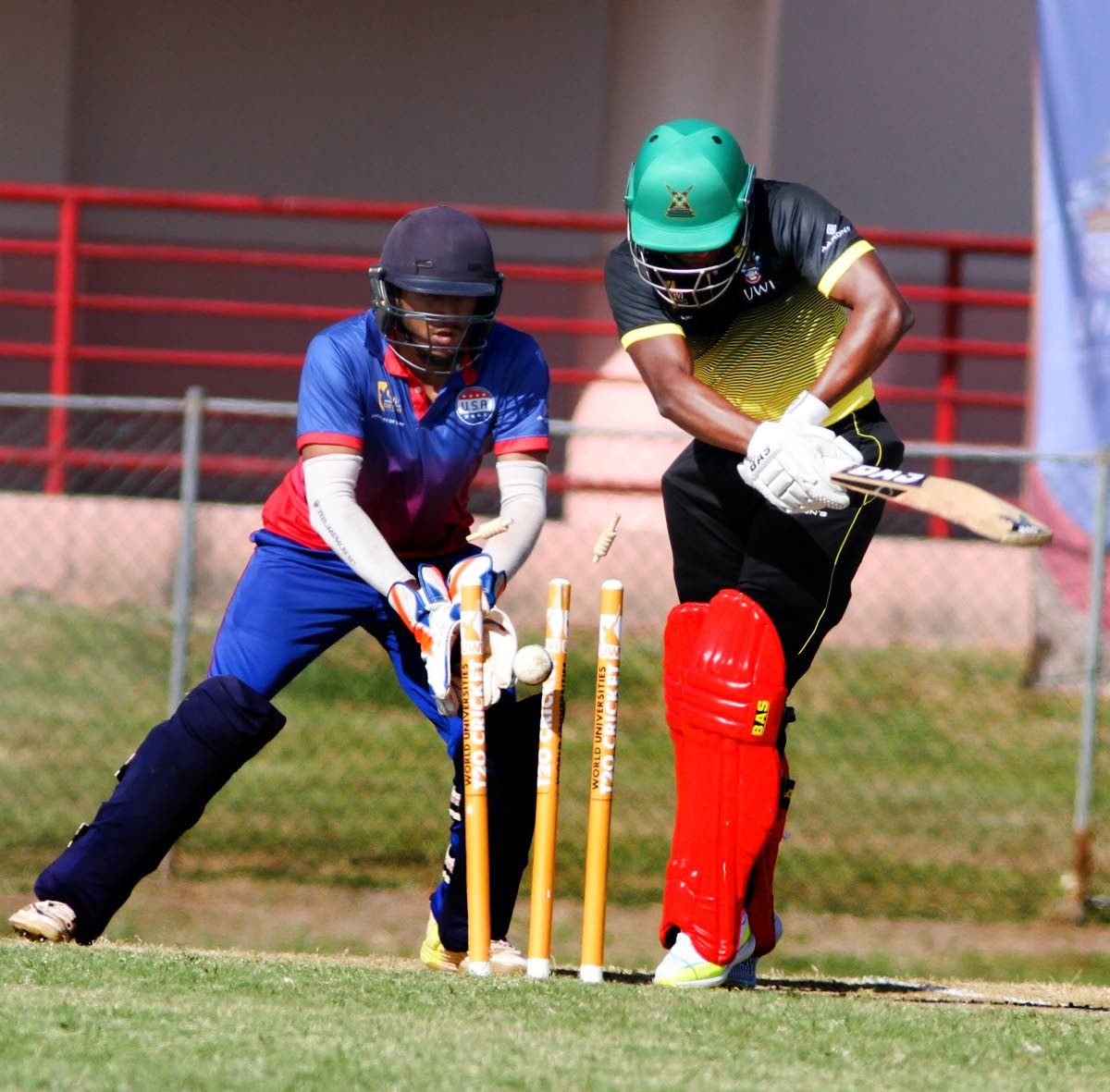 UWI's Stephen Katwaroo is bowled in USA Combined Universities yesterday, at the Sir Frank Worrell Ground, St Augustine.