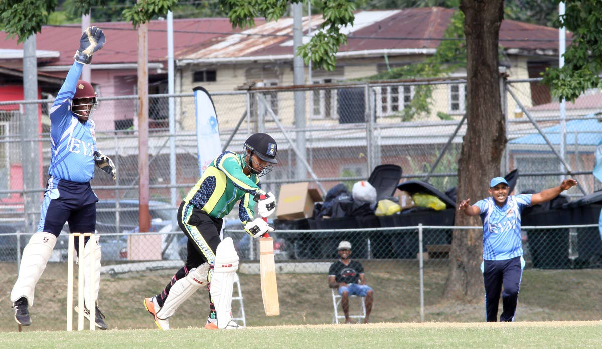 EL Socorro Youth Movement players make a successful appeal for LBW against Clarke Road's Nicholas Sookdeosingh, in their UWI-Unicom T20 match, at the Sir Frank Worrell Ground, yesterday.