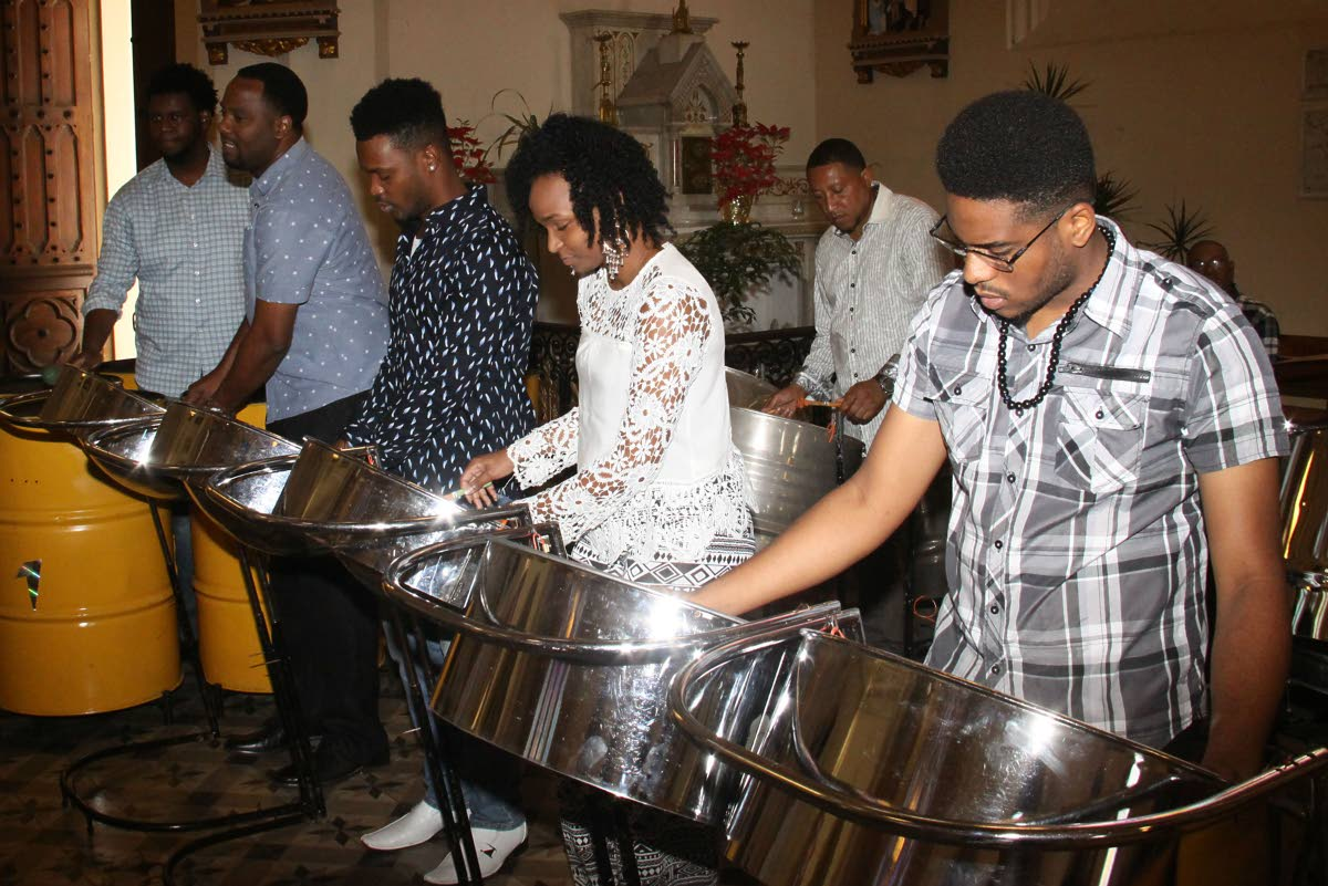 CHURCH PAN: Members of Trinidad All Stars Steel Orchestra play during their thanksgiving service yesterday at the Holy Rosary Church in Port of Spain. PHOTO BY ANGELO MARCELLE
