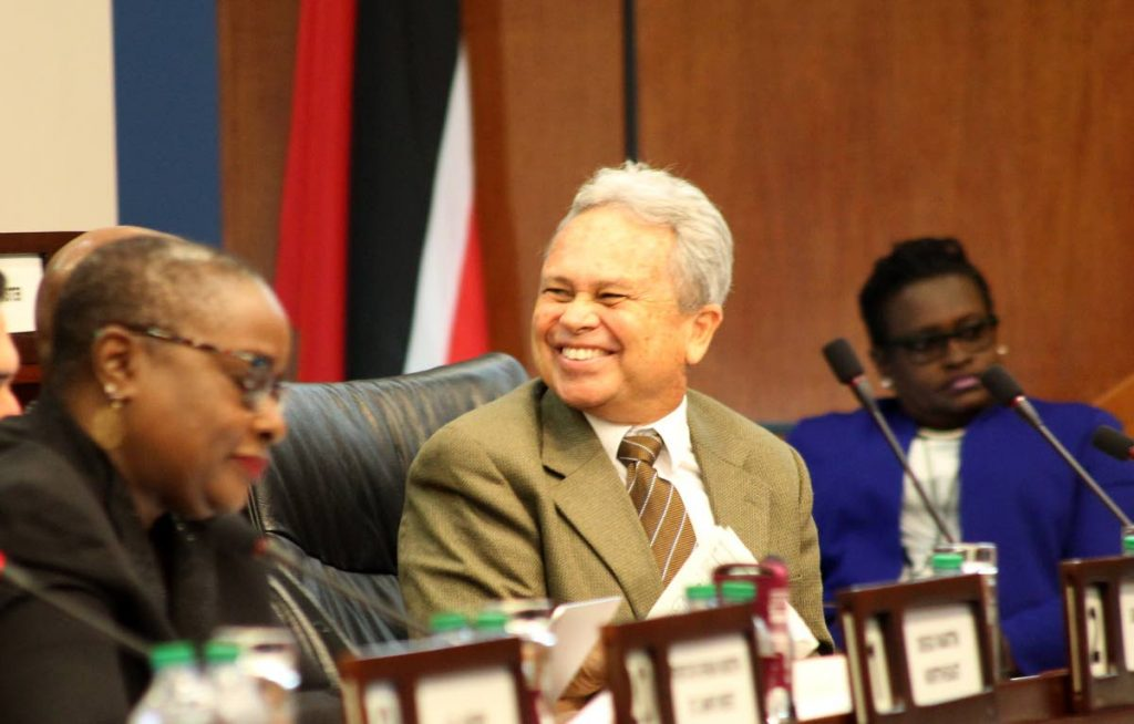 Finance Minister Colm Imbert is all smiles during a meeting of the Finance Standing Committee in Parliament on January 14. The House approved the committee's report for fiscal 2018 on Friday.. PHOTO BY ROGER JACOB