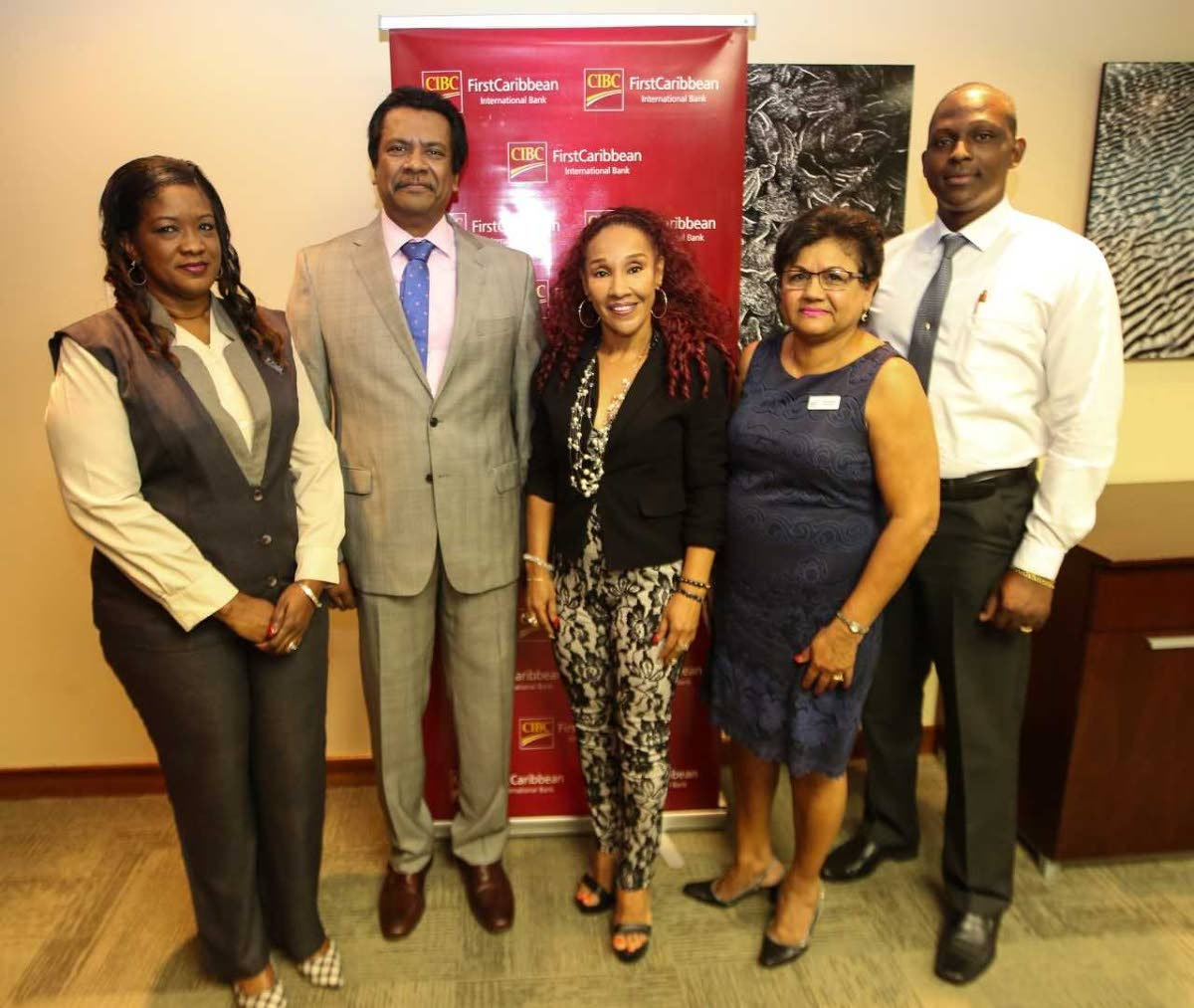 Managing director of CIBC FirstCaribbean Trinidad Operations, Anthony Seeraj, second left,  with   Sherma Mills-Serrette, left, clinic manager of the TTCancer Society  ; entertainer Marcia Miranda representing her charity Children with Cancer Support Group; Lilia Mootoo, general manager of Vitas House; and Kevin Cox, general manager of the Cancer Society.