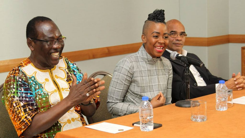 Soca Monarch founder William Monroe and newly-appointed chairman of Caribbean Prestige Foundation (CPF), Fay Ann Lyons-Alvarez, enjoy a joke at a press conference at the Hyatt last month.  Looking on is CPF director Geoffrey Wharton-Lake.   PHOTO BY ROGER JACOB