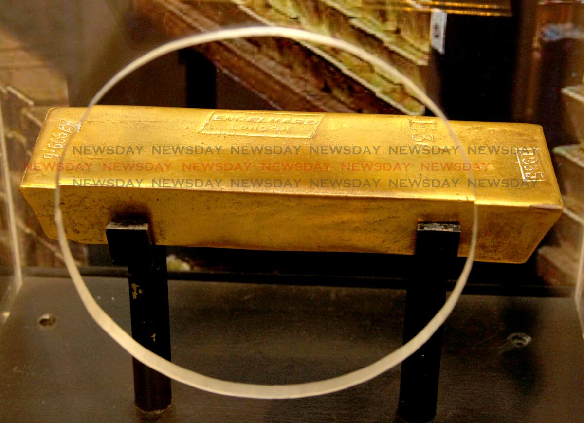 WORTH ITS WEIGHT: A bar of pure gold was one of the major attractons at the reopening on Tuesday of the Central Bank Museum. PHOTO BY ROGER JACOB