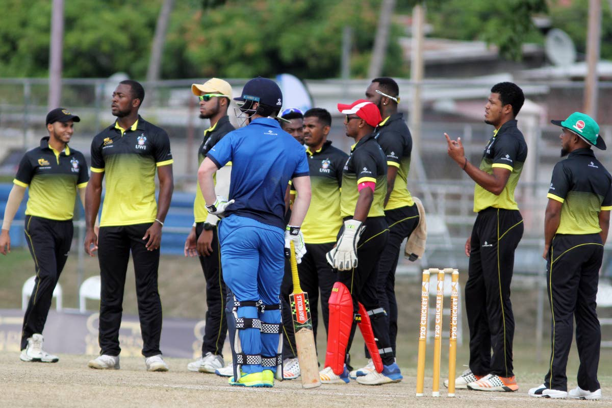 UWI players wait on an umpiring decision against Oxford in their World Universities T20 match at the Sir Frank Worrell Ground, St Augustine, yesterday. PHOTO BY SUREASH CHOLAI