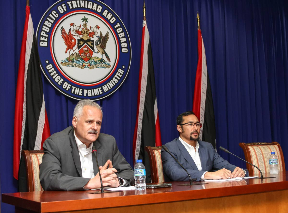Sandals Resorts International chief executive officer, Gebhard Rainer, left, and National Security Minister Stuart Young address media following the announcement that it was withdrawing participation in a Sandals Tobago project.    Photo: Jeff K Mayers