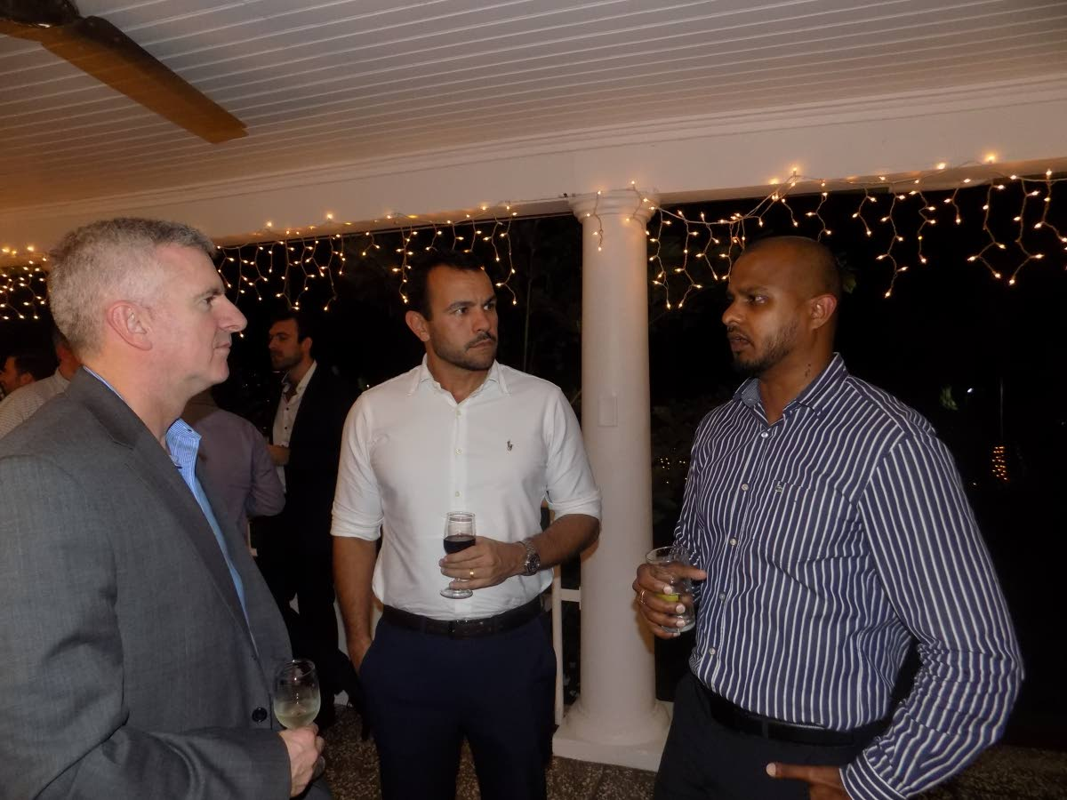 Business development manager at Massy Wood Vijay Jaggassar, right, speaks to RST Global managing director Eduardo Varela and VP of operations at Petrofac Kevin Mackie during a cocktail reception at the British High Commissioner's Maraval residence on Monday night. PHOTO BY SHANE SUPERVILLE