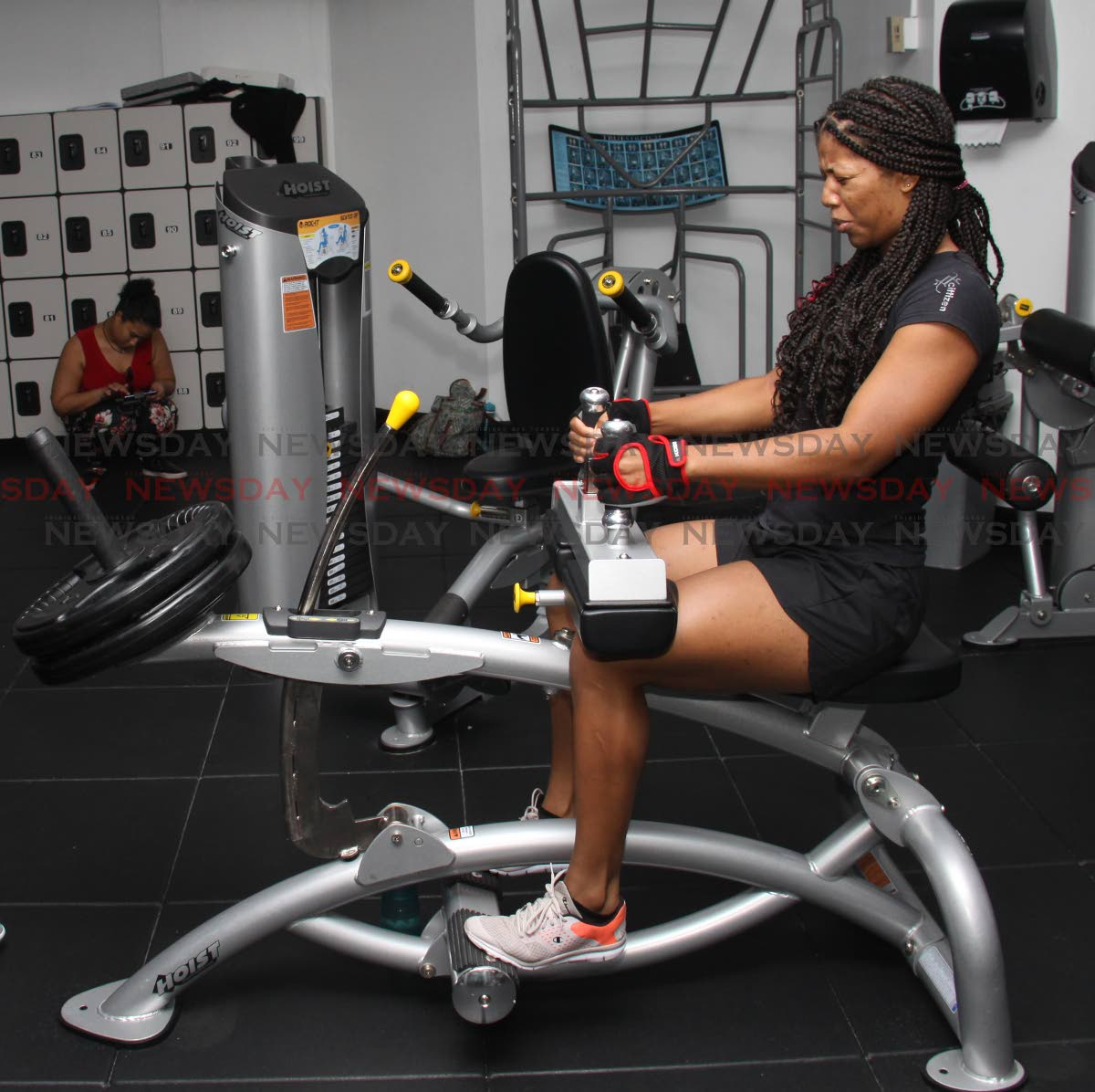 Sherainne Taylor feels the burn from this workout at D Dial Fitness Club, Long Circular Mall, St James.