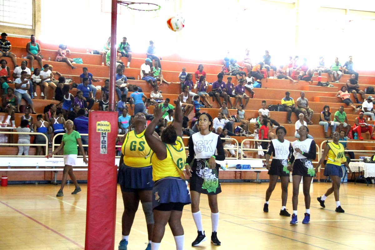 A Defence Force player takes a shot against TSTT in a recent championship division match in the Courts All Sectors Netball League at the Eastern Regional Indoor Sports Arena, Tacarigua. PHOTO BY SUREASH CHOLAI