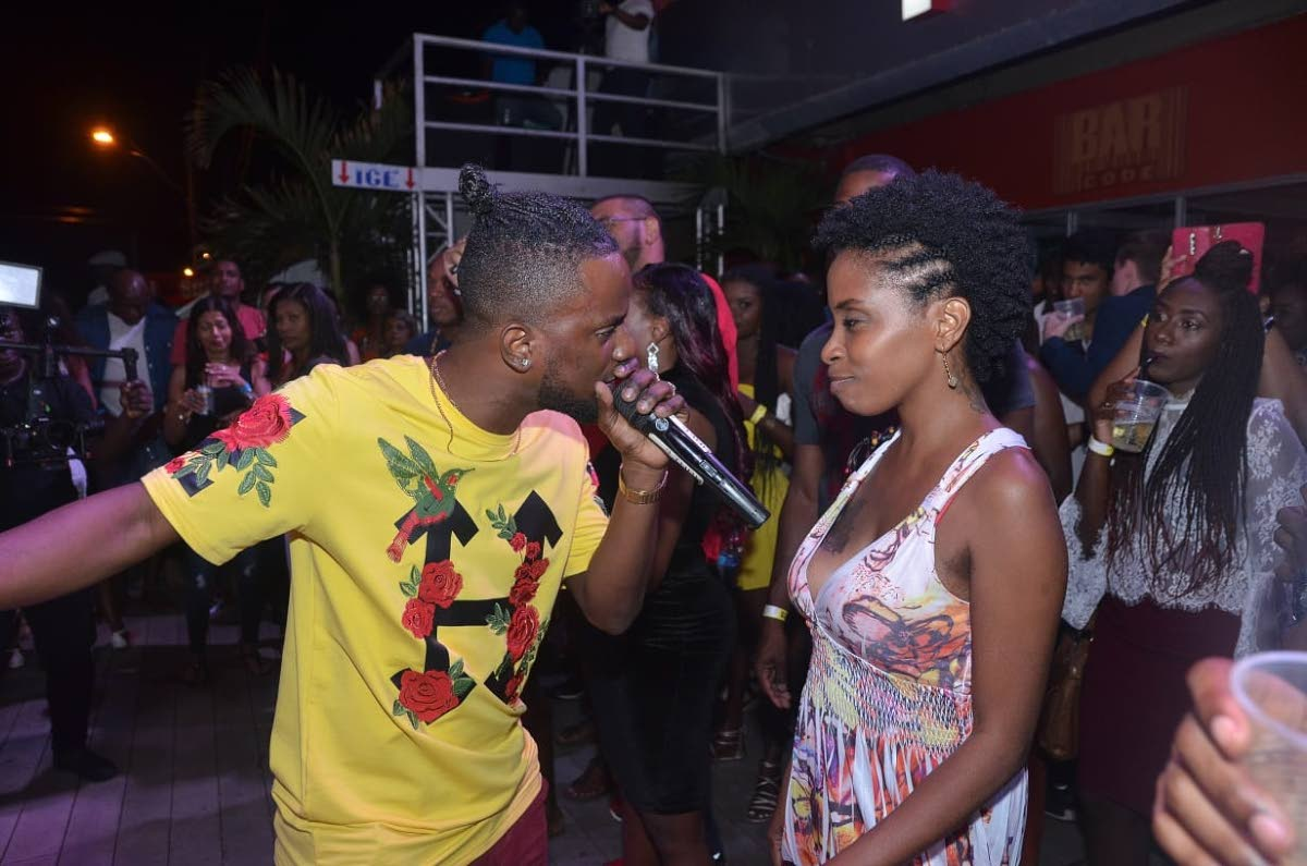 "Reigning New Tobago Soca Monarch, Jhevon ""Royale"" Jackson sings to a patron at Barcode's first event in the series, 'I Love Soca,' last week Tuesday at the Milford Road, Scarborough club."