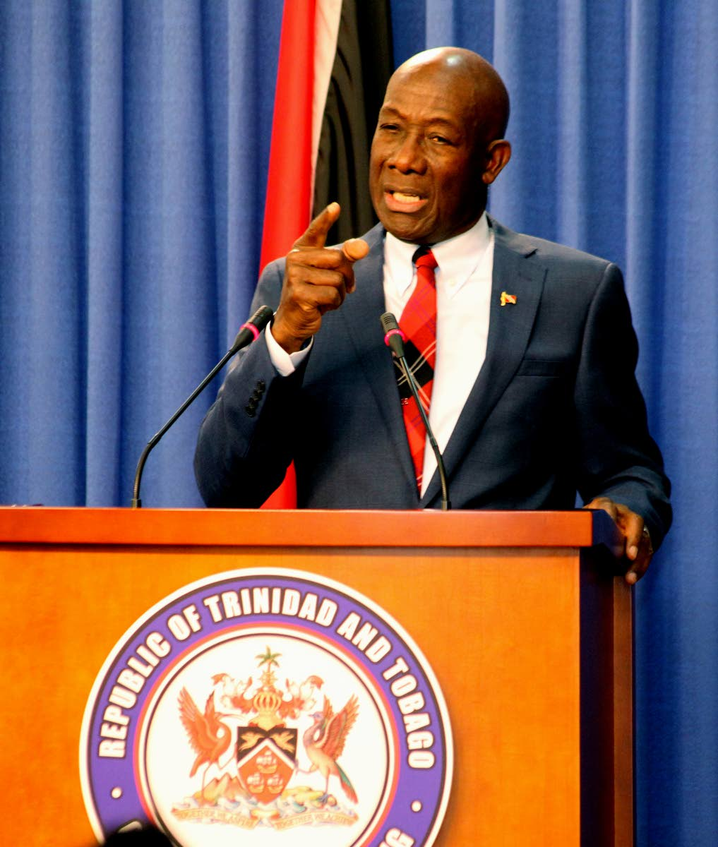 Prime Minister Dr Keith Rowley addresses the members of the media. PHOTO BY ROGER JACOB