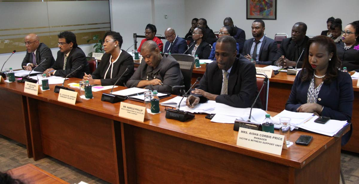 (left to right) Ministry of Education PS Kurt Meyer, acting chief education officer John Roopchan,  Children's Authority director Safiya Noel, Office of the PM PS Jacqueline Johnson, acting deputy police commissioner Harold Phillip and TTPS Victim and Witness Support Unit manager,Aisha Corbie-Price at the Joint Select Committee on Human Rights, Equality and Diversity in Parliament on Friday. The committee disclosed cases of girls engaging in porn. PHOTO BY ANGELO MARCELLE