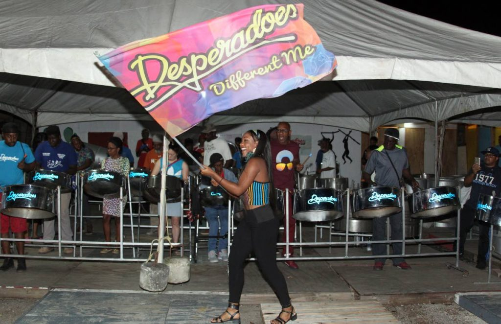 Nailah Blackman waves a Desperadoes flag as the band rehearses her song Iron Man, it's tune of choice for Panorama, at the panyard on the old government printery compound, Tragerete Road, Port of Spain last Thursday. PHOTO BY ROGER JACOB