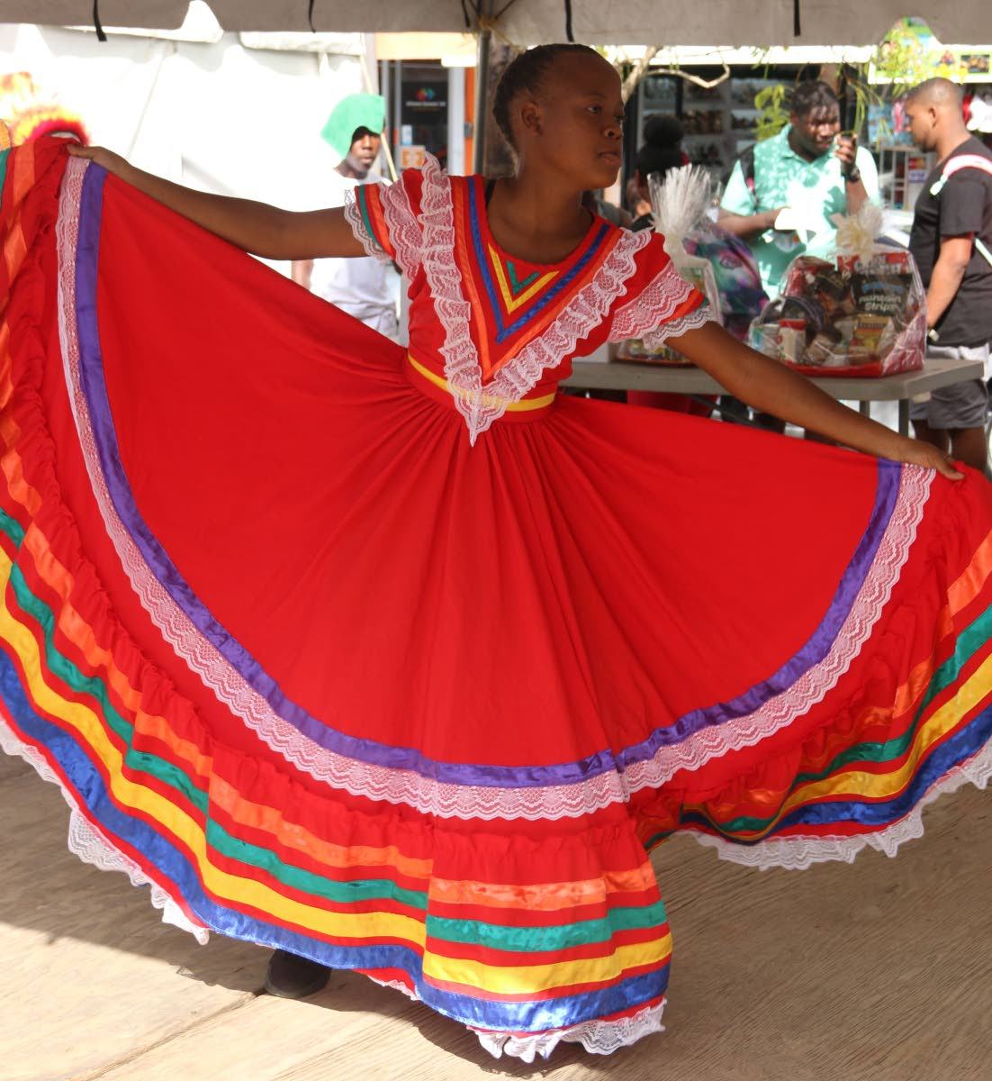 Oneca Bailey of Moruga Secondary School performs a dance at the launch of Princes Town Carnival on Friday.
