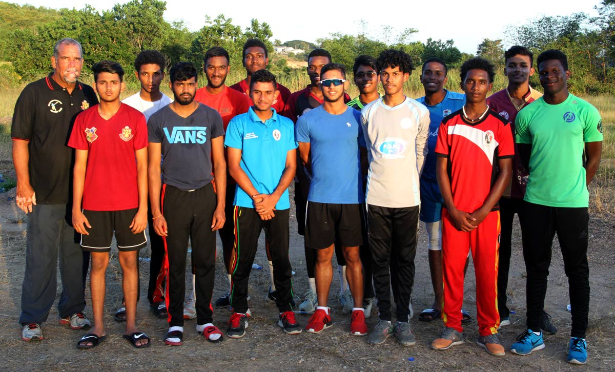 Coach Richard Kelly,back row left, and members of the Hillview College cricket team, at the team practise session, at Honeymoon Park, Tunapuna, yesterday.