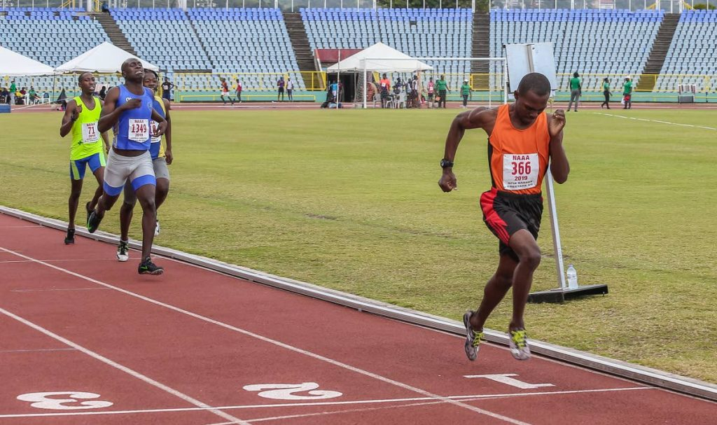 Otis Barker of Cheetahs, right, leaves his opponents viewing his heels as he wins the Men's 800m final in the NAAA/NGC Track and Field Series yesterday. PHOTO BY JEFF MAYERS