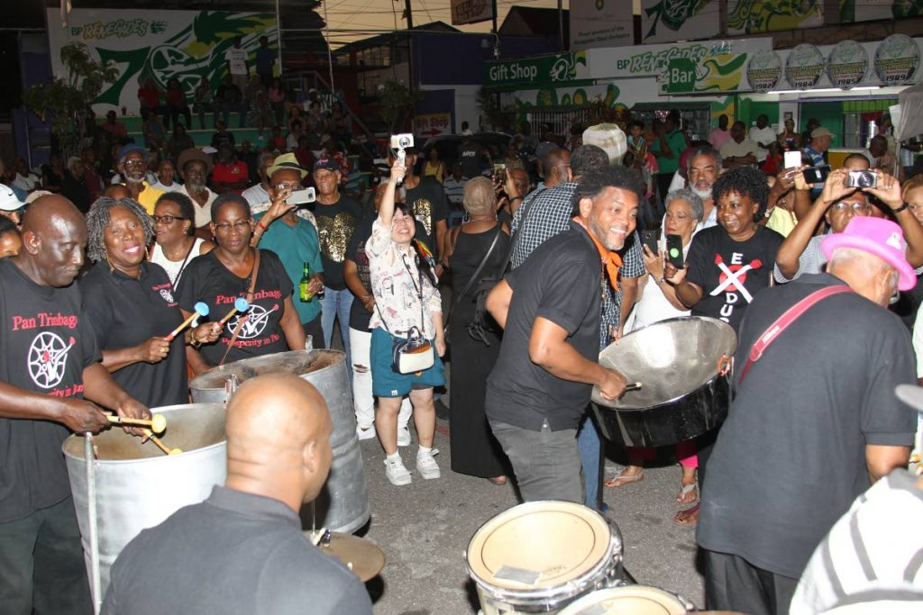 Pan Trinbago president Beverley Ramsey-Moore, second from left, and members of her executive perform as a band at the official launch of Panorama 2019, hosted at BP Renegades panyard, Charlotte Street, Port of Spain yesterday. PHOTO BY ROGER JACOB