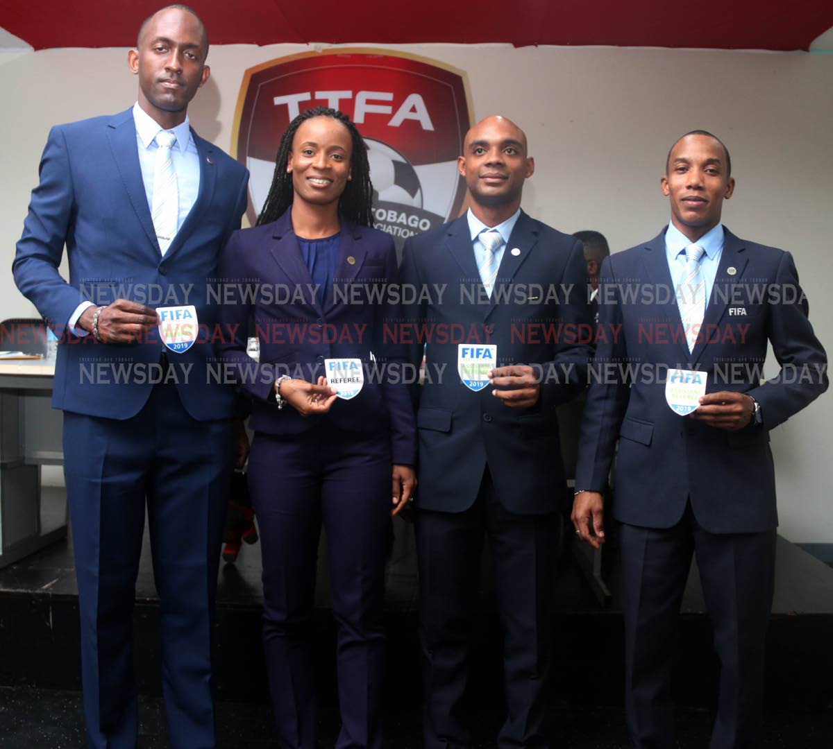 FIFA REFEREES: Showing off their 2019 FIFA badges yesterday are (from left) Caleb Wales, Crystal Sobers, Joseph Bertrand and Ainsley Rochard, at the TT Football Association head office at the Ato Boldon Stadium in Couva. PHOTO BY ANSEL JEBODH