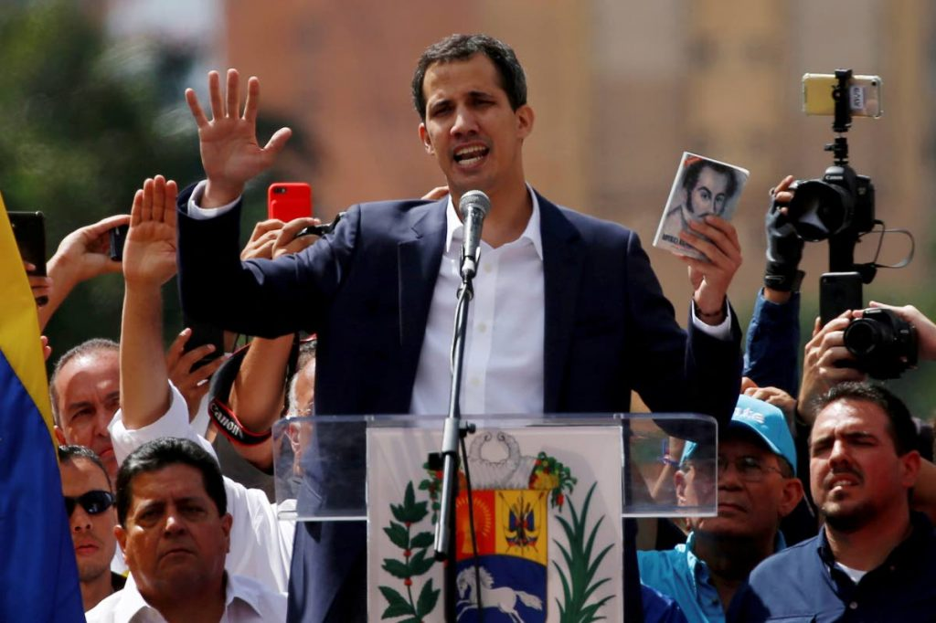 Juan Guaido, head of Venezuela's opposition-run congress, declares himself interim president of Venezuela, during a rally demanding President Nicolas Maduro's resignation in Caracas, Venezuela, last Wednesday. FILE PHOTO