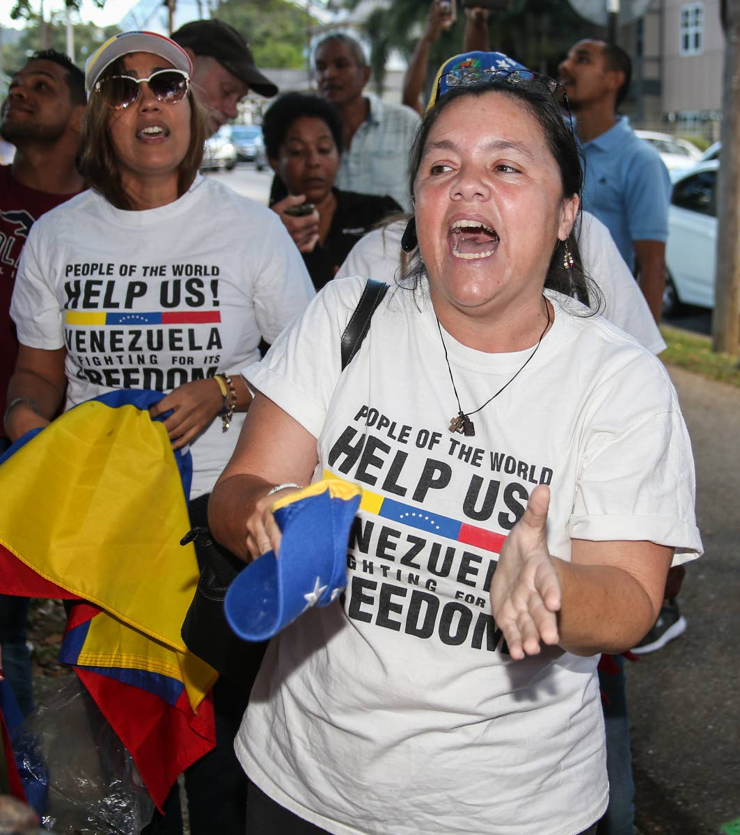 LIBERTAD: Venezuelan Ruth Albornoz chants as she and other Venezuelans assembled in the Queen's Park Savannah in Port of Spain on Friday in support of National Assembly president Juan Guaido declaring himself President of Venezuela. PHOTO BY JEFF MAYERS
