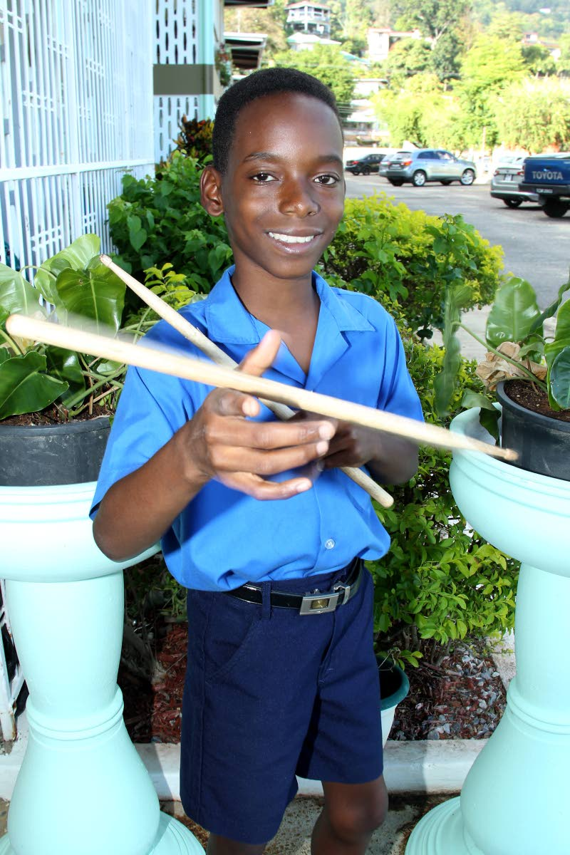 """Drumming is """"a way to express myself,"""" says Joaquinn Headley as he flicks his drum sticks. PHOTO BY ROGER JACOB"""