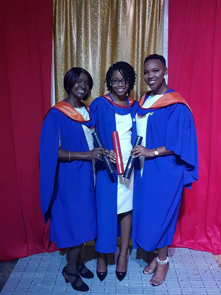 Judith Chase, left, with her daughters, Sonja and Siobhan Chase, right, at their October 2018 graduation from the University of the West Indies. All three graduated on the same day from the same faculty, Social Sciences.