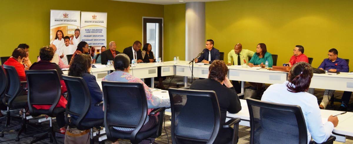Education Minister Anthony Garcia, centre at right, and ministry officials in a meeting with a TTUTA delegation, including president Lynsley Doodhai, at the ministry in Port of Spain on Friday. PHOTO COURTESY EDUCATION MINISTRY