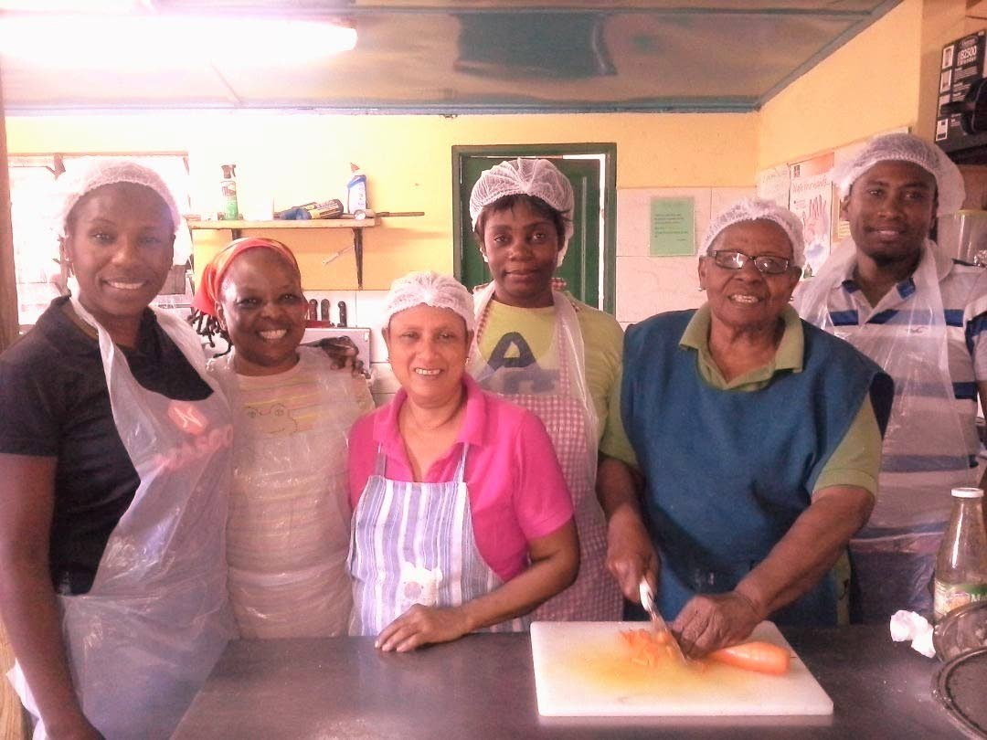 Entrepreneur Sylvia Dates-Lindsay, second from right, stands with some of her employees at Sylvia's restaurant in Bon Accord.